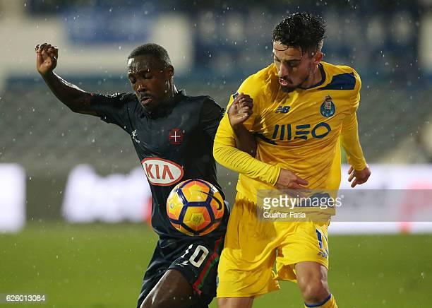 Belenenses's forward Gerso from Portugal with FC Porto's defender from Brazil Alex Telles in action during the Primeira Liga match between Os...