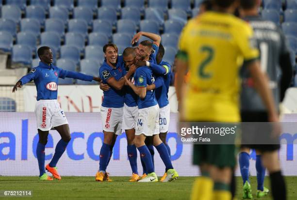 Belenenses's forward Maurides from Brazil celebrates with teammates after scoring a goal during the Primeira Liga match between CF Os Belenenses and...