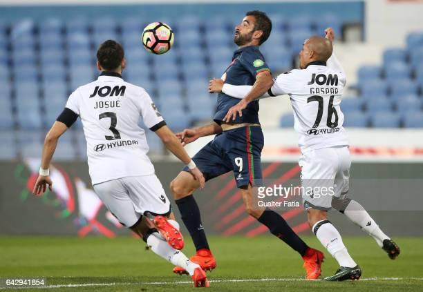 Belenenses's forward Tiago Caeiro from Portugal with Vitoria Guimaraes' defender Bruno Gaspar and Vitoria GuimaraesÕ defender Josue Sa in action...