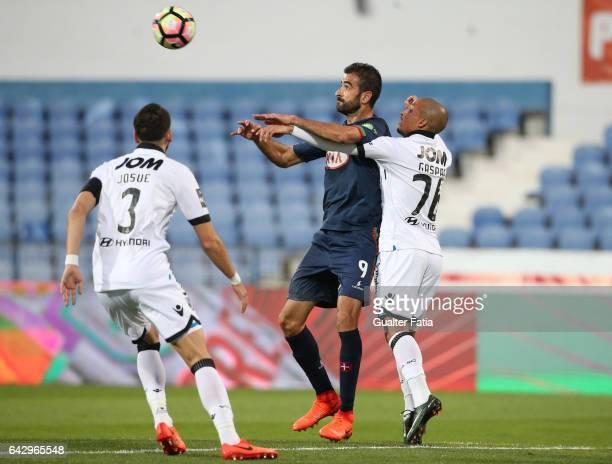 Belenenses's forward Tiago Caeiro from Portugal with Vitoria Guimaraes defender Bruno Gaspar and Vitoria Guimaraes defender Josue Sa in action during...