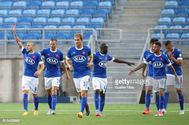 Belenenses's midfielder Andre Sousa from Portugal celebrates with teammates after scoring a goal during the PreSeason Friendly match between Sporting...