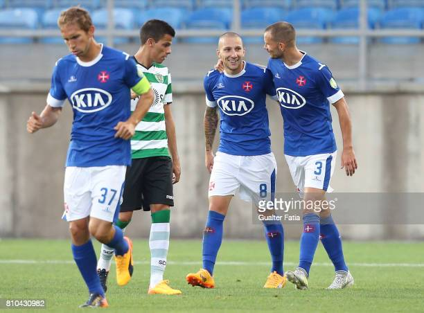 Belenenses's midfielder Andre Sousa from Portugal celebrates with teammate Belenenses's defender Persson from Sweden after scoring a goal during the...