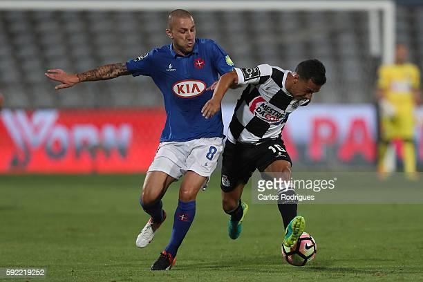 Belenenses's midfielder Andre Sousa from Portugal vies with Boavista's midfielder Fabio Espinho from Portugal during the Portuguese Primeira Liga...
