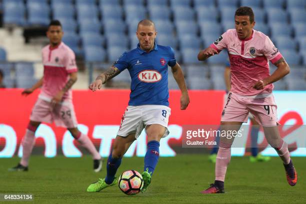 Belenenses's midfielder Andre Sousa from Portugal with Chaves's midfielder Davidson from Brazil in action during the Primeira Liga match between CF...