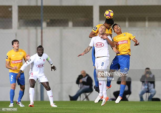 Belenenses's midfielder Andre Sousa from Portugal with Estoril's defender Ailton Silva from Brazil and Estoril's forward Gustavo Tocantins from...