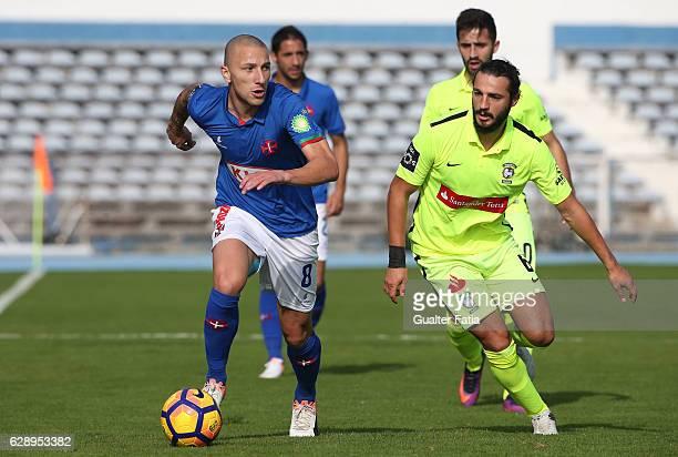 Belenenses's midfielder Andre Sousa from Portugal with CS Maritimo's midfielder Erdem Sen from Turkey in action during the Primeira Liga match...