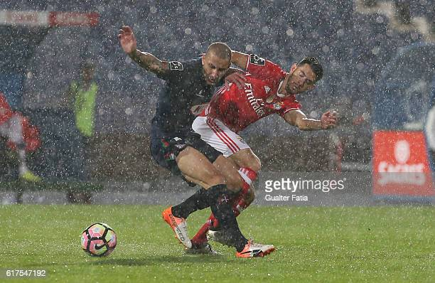 Belenenses's midfielder Andre Sousa from Portugal with SL Benfica's midfielder Pizzi in action during the Primeira Liga match between Belenenses and...