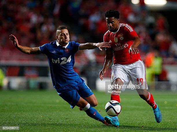 Belenenses's midfielder Andre Sousa vies for the ball with Benfica's defender Eliseu during the Portuguese League football match between SL Benfica...