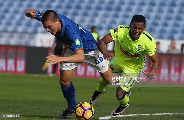 Belenenses's midfielder Joao Palhinha from Portugal tackled by CS Maritimo's midfielder Eber Bessa from Brazil during the Primeira Liga match between...