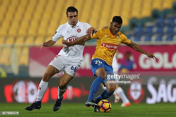 Belenenses's midfielder Joao Palhinha from Portugal vies with Estoril's midfielder Matheus Indio from Brazil during the match between Estoril Praia...