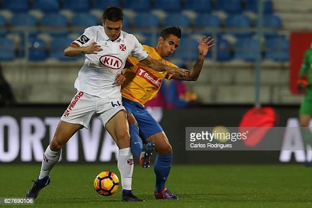 Belenenses's midfielder Joao Palhinha from Portugal vies with Estoril's midfielder Eduardo Teixeira from Brazil during the match between Estoril...