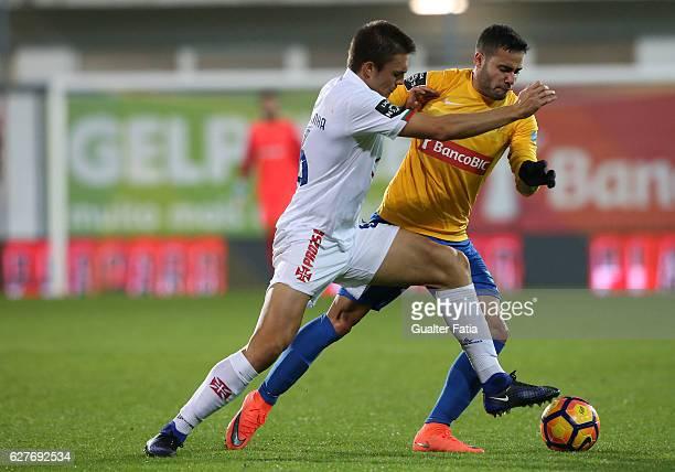 Belenenses's midfielder Joao Palhinha from Portugal with Estoril's midfielder Eduardo Teixeira from Brazil in action during the Primeira Liga match...