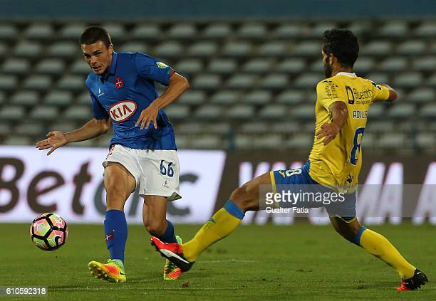 Belenenses's midfielder Joao Palhinha from Portugal with FC AroucaÕs midfielder from Brazil Adilson Tavares in action during the Primeira Liga match...