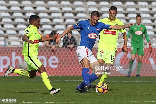 Belenenses's midfielder Joao Palhinha from Portugal with CS Maritimo's forward Edgar Costa from Portugal and CS Maritimo's midfielder Eber Bessa from...