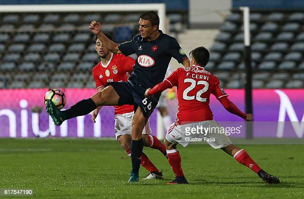 Belenenses's midfielder Joao Palhinha from Portugal with SL Benfica's midfielder Pizzi and SL Benfica's forward from Argentina Franco Cervi in action...
