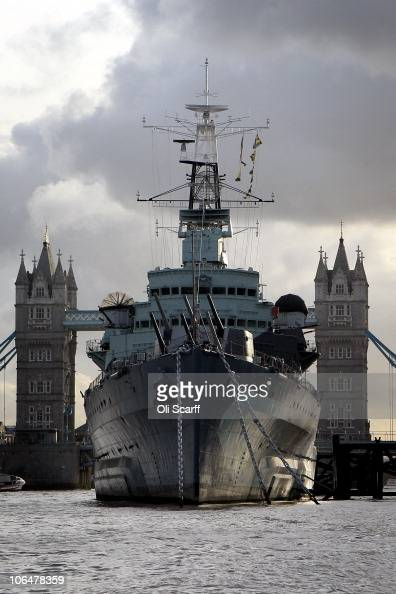 Belfast a decommissioned Navy warship now used as a museum is moored in front of Tower Bridge on November 3 2010 in London England With less than two...