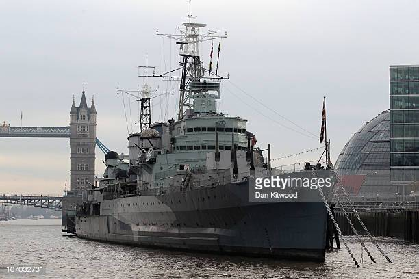 Belfast a decommissioned Navy warship now used as a museum is moored in front of Tower Bridge on November 15 2010 in London England With less than...