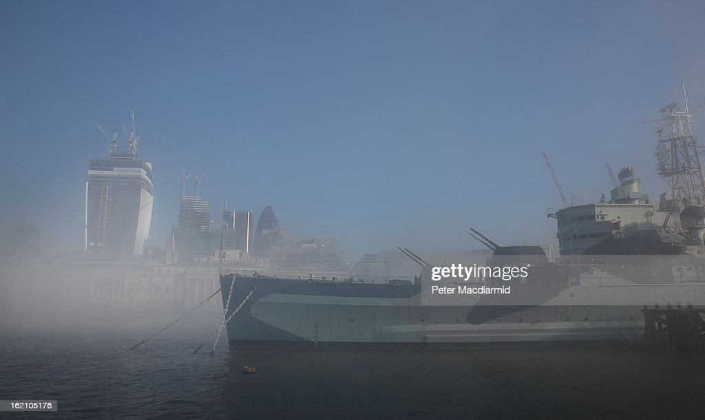 Belfast and The City of London financial district emerge from ealy morning fog on The River Thames on February 19, 2013 in London, England. Heathrow was forced to cancel a number of flights and London City Airport suffered distruptions as a result of poor visibility due to fog.