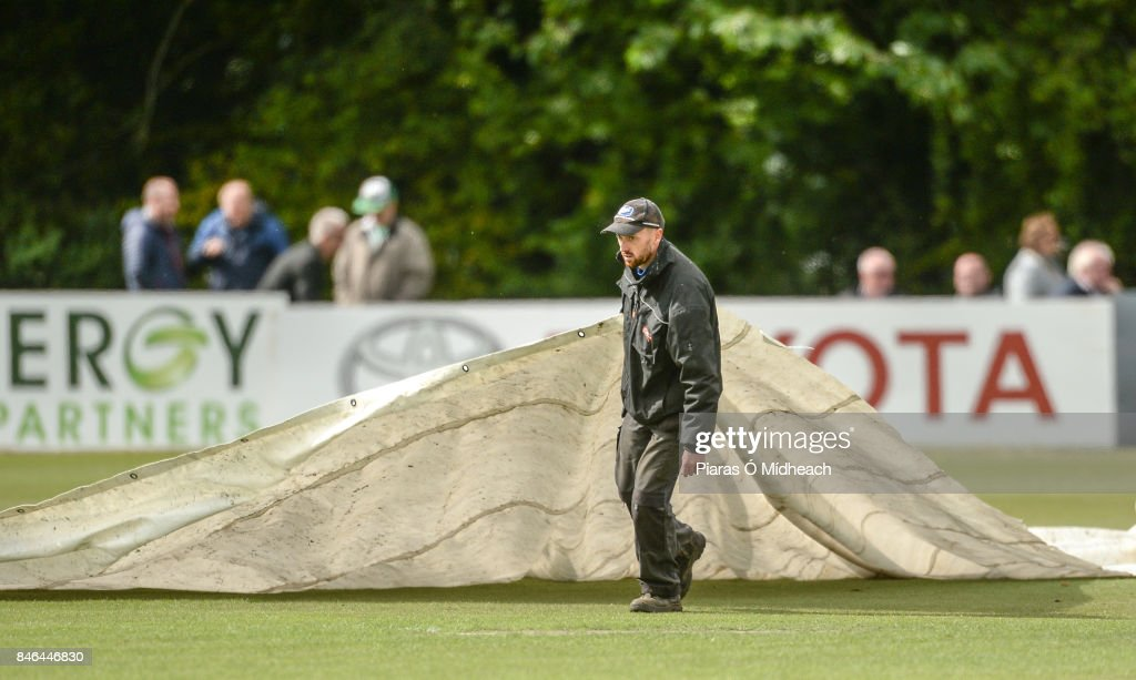 Belfast , Ireland - 13 September 2017; Covers are brought onto the pitch before the One Day International match between Ireland and West Indies was cancelled due to a wet pitch, at Stormont in Belfast.