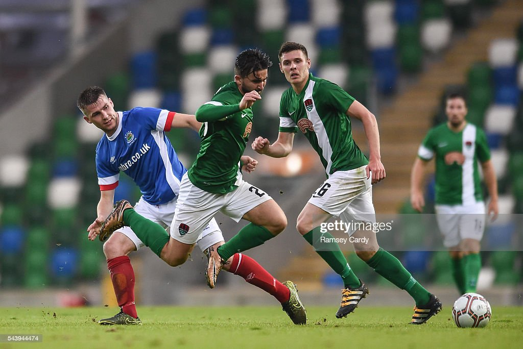 Belfast , Ireland - 30 June 2016; Sean Maguire of Cork City is tackled by Stephen Lowry of Linfield during the UEFA Europa League First Qualifying Round 1st Leg game between Linfield and Cork City at Windsor Park in Belfast.