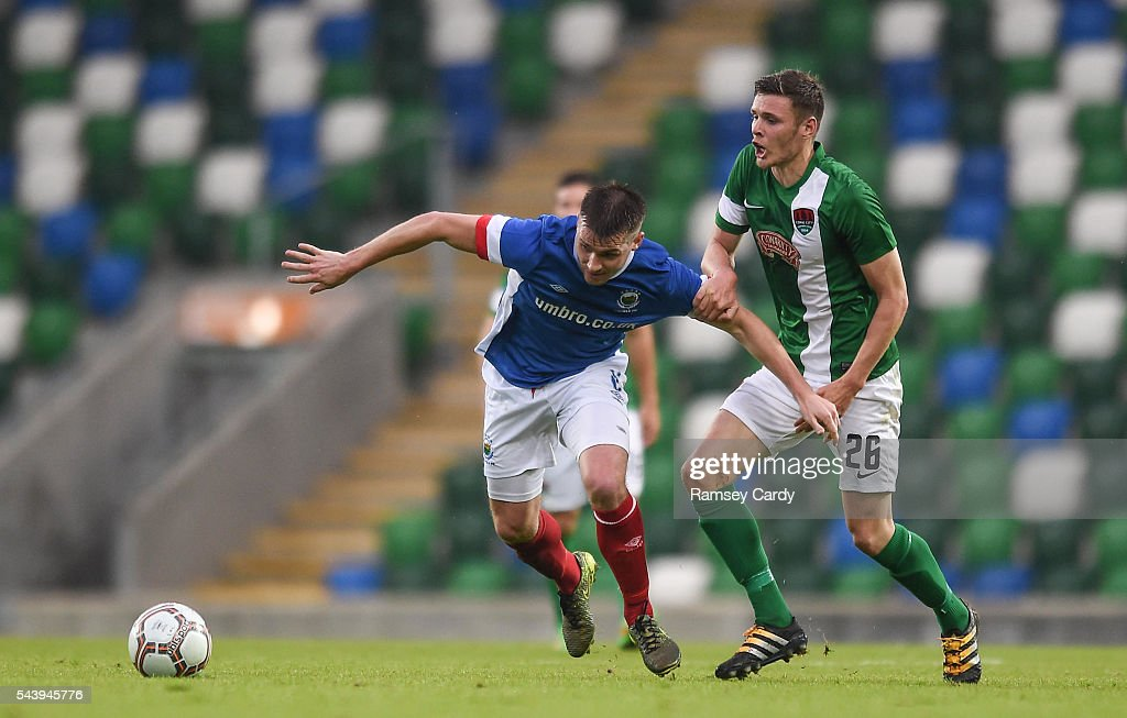 Belfast , Ireland - 30 June 2016; Stephen Lowry of Linfield is tackled by Garry Buckley of Cork City during the UEFA Europa League First Qualifying Round 1st Leg game between Linfield and Cork City at Windsor Park in Belfast.