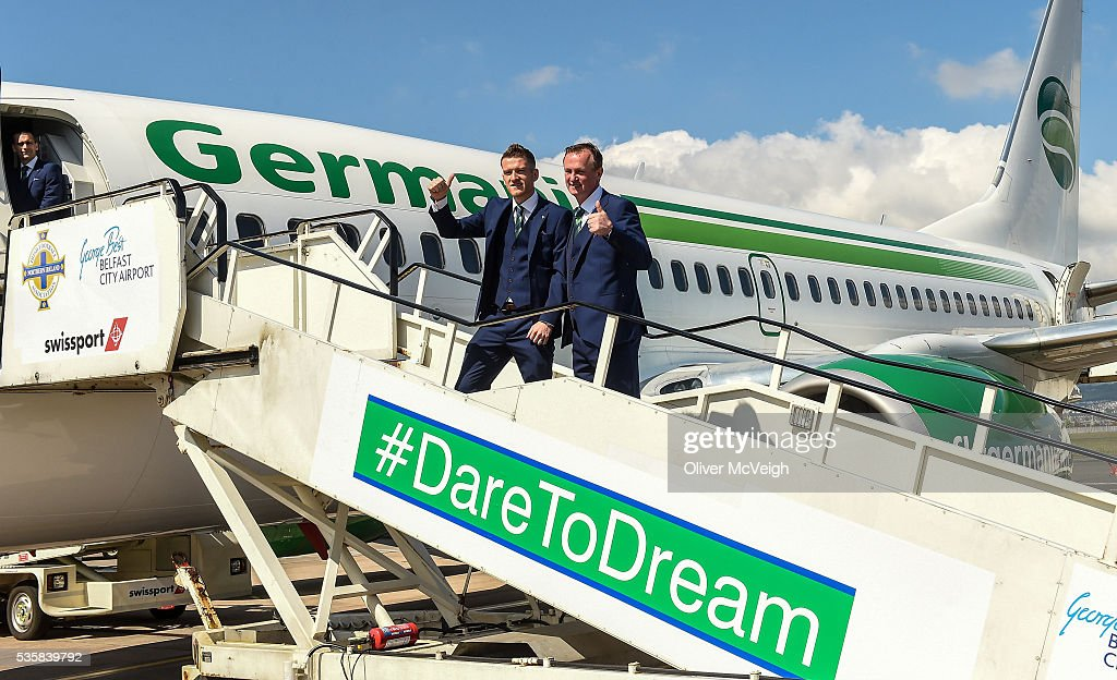 Belfast , Ireland - 30 May 2016; Northern Ireland captain Steven Davis and manager <a gi-track='captionPersonalityLinkClicked' href=/galleries/search?phrase=Michael+O%27Neill+-+Fu%C3%9Fballtrainer&family=editorial&specificpeople=15096916 ng-click='$event.stopPropagation()'>Michael O'Neill</a> as the squad departs for EURO2016 from George Best City Airport, Belfast.