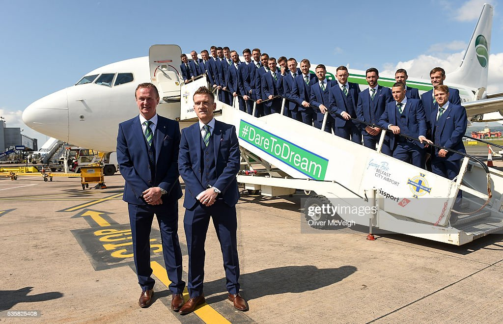 Belfast , Ireland - 30 May 2016; Northern Ireland manager <a gi-track='captionPersonalityLinkClicked' href=/galleries/search?phrase=Michael+O%27Neill+-+Allenatore+di+calcio&family=editorial&specificpeople=15096916 ng-click='$event.stopPropagation()'>Michael O'Neill</a>, left, and captain Steven Davis along with the Northern Ireland squad as it departs for EURO2016 from George Best City Airport, Belfast.