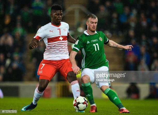 Belfast Ireland 9 November 2017 Chris Brunt of Northern Ireland in action against Breel Embolo of Switzerland during the FIFA 2018 World Cup...