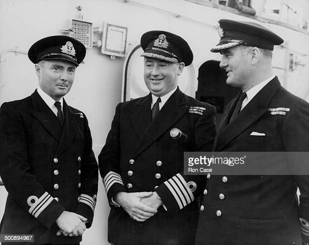 HMS Belfast returning to to Britain from Korea Lieutenant Commander H O'Gilby Captain Sir Aubrey St ClairFord and Commander W Fitzroy standing on...