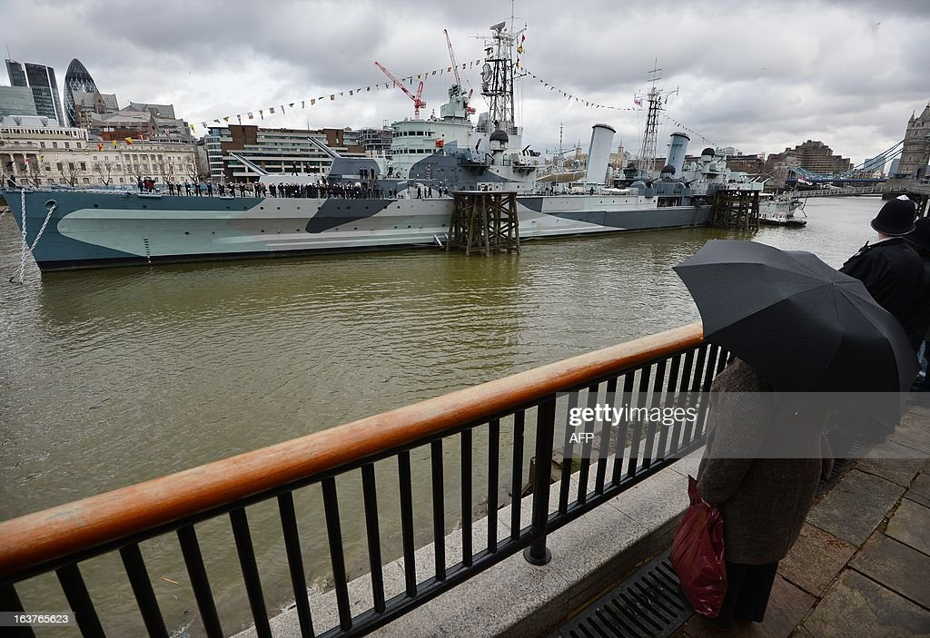 HMS Belfast sails past during a ceremony marking its 75 anniversary in London on March 15, 2013. HMS Belfast is a large light cruiser of the Town-class which saw action in the Second World War and the Far East 1946-1950 and is now a museum ship moored on the River Thames just in front of Tower Bridge. HMS Belfast was launched on March 17, 1938 and was decommissioned in 1965 becoming part of the Imperial War Museum in 1978. The ship celerbates this year in 2013 its 75th anniversary.