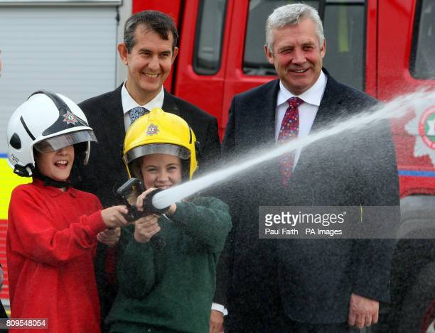 Belfast school pupils Ronan McIvenny and Emma Chambers join Northern Ireland Government Public Safety Minister Edwin Poots and Fergus O'Dowd TD...