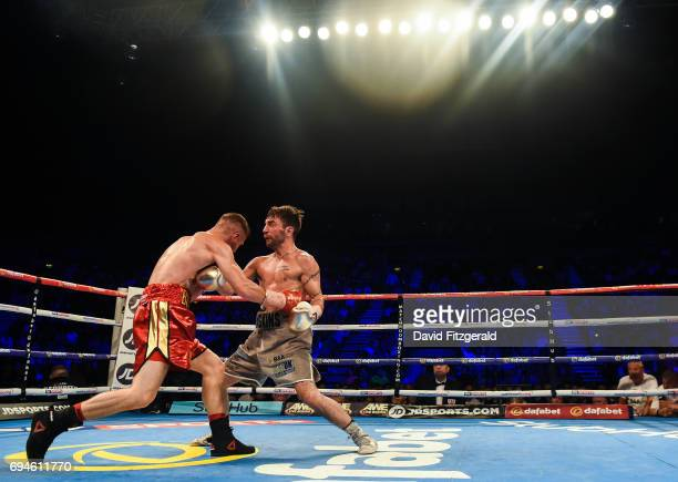 Belfast United Kingdom 10 June 2017 Lee Haskins right exchanges punches with Ryan Burnett during their IBF World Bantamweight Championship bout at...