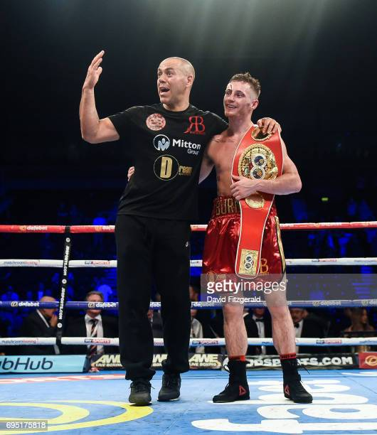 Belfast United Kingdom 10 June 2017 Ryan Burnett right celebrates with his trainer Adam Booth following his victory over Lee Haskins in their IBF...