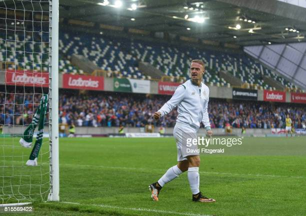 Belfast United Kingdom 14 July 2017 Leigh Griffiths of Celtic ties a Celtic scarf around the goalpost following the UEFA Champions League Second...