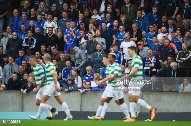 Belfast United Kingdom 14 July 2017 Linfield supporters look on as Tom Rogic of Celtic celebrates with teammates after scoring his side's second goal...