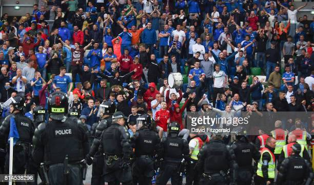 Belfast United Kingdom 14 July 2017 Riot police form a line in front of the Linfield supporters following the UEFA Champions League Second Qualifying...