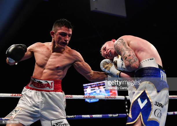 Belfast United Kingdom 18 November 2017 Carl Frampton right in action against Horacio Garcia during their featherweight bout at the SSE Arena in...