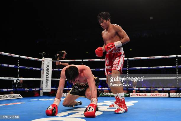 Belfast United Kingdom 18 November 2017 Jamie Conlan recovers from a knock down by Jerwin Ancajas during their IBF World super flyweight Title bout...