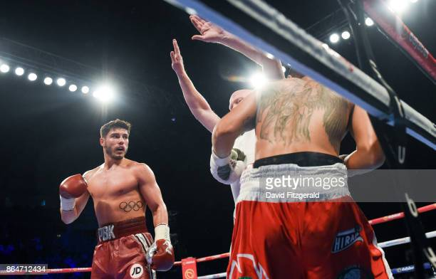 Belfast United Kingdom 21 October 2017 Josh Kelly left watches on as his Welterweight bout with Jose Luis Zuniga is called to a stoppage by the...