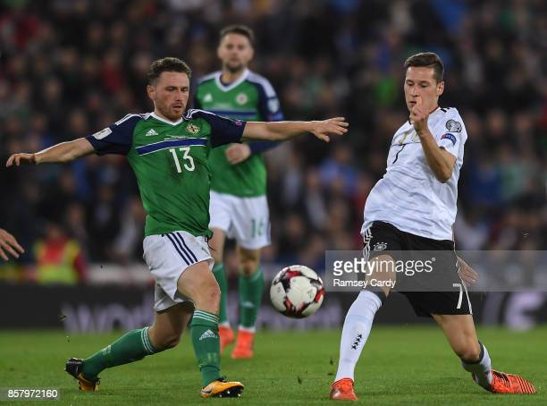 Belfast United Kingdom 5 October 2017 Julian Draxler of Germany in action against Corey Evans of Northern Ireland during the FIFA World Cup Qualifier...