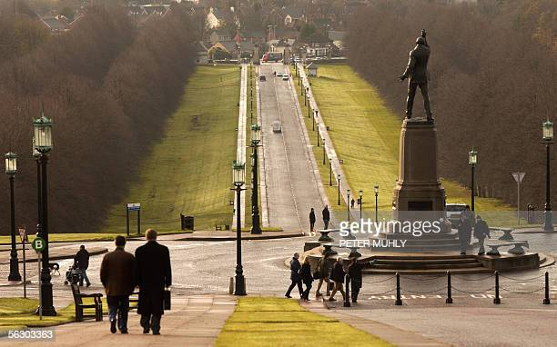 People walk along the road leading to Stormont Parliament building 30 November 2005 in Belfast Northern Ireland Up to 500000 people are excepted to...