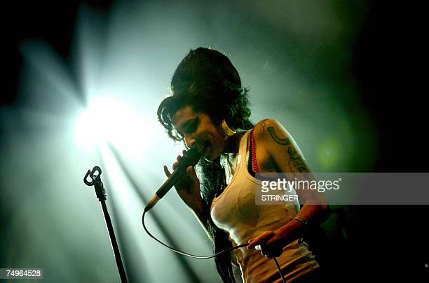 British singer Amy Winehouse performs on stage 29 June 2007 during the Eurockeennes Music Festival in Belfort Eastern France AFP PHOTO JEFF PACHOUD
