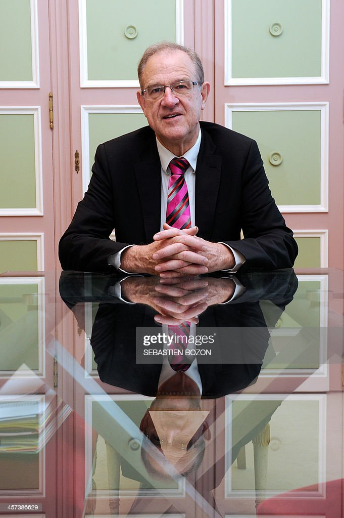 Belfort's mayor and Socialist party's candidate for his own succesion in the 2014 municipal elections, Etienne Butzbach, poses at his office in the city hall on December 17, 2013 in Belfort, eastern France. AFP PHOTO / SEBASTIEN BOZON