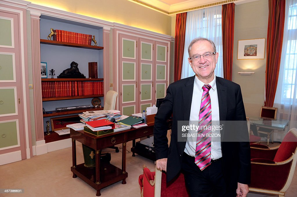 Belfort's mayor and Socialist party's candidate for his own succesion in the 2014 municipal elections, Etienne Butzbach, poses at his office in the city hall on December 17, 2013 in Belfort, eastern France.