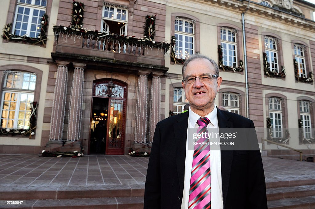Belfort's mayor and Socialist party's candidate for his own succesion in the 2014 municipal elections, Etienne Butzbach, poses in front of the city hall on December 17, 2013 in Belfort, eastern France. AFP PHOTO / SEBASTIEN BOZON