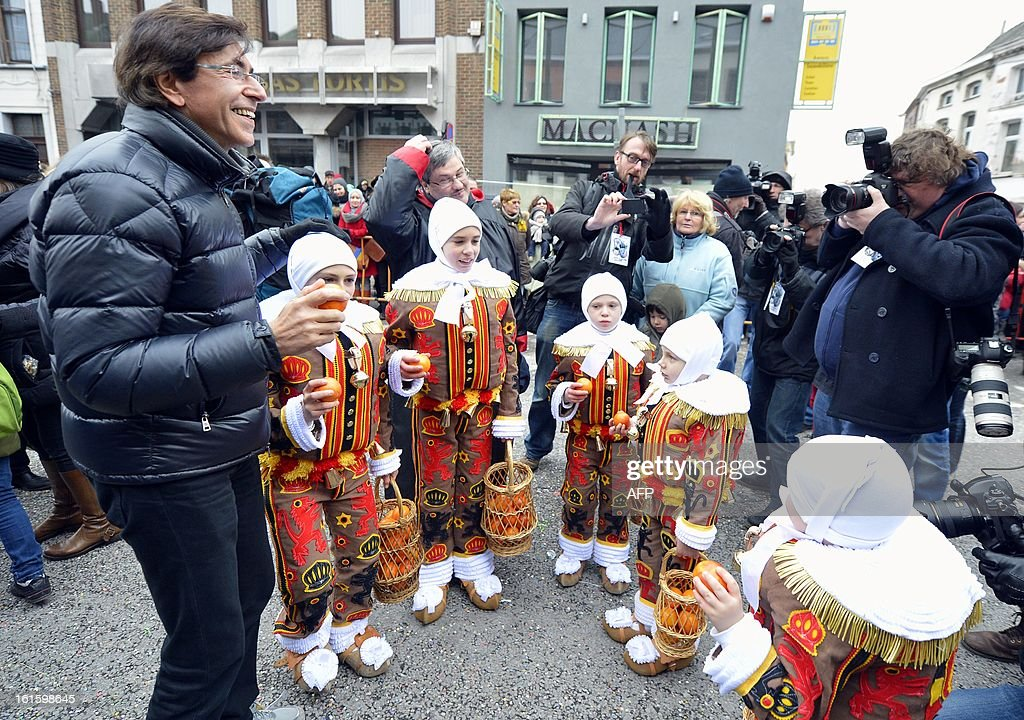 Belgain Prime Minister Elio Di Rupo (L) and young 'Gilles' discuss as the carnival takes place in the streets of Binche, on February 12, 2013. The Binche Carnival tradition is one of the most ancient and representative of Wallonia and inscribed in 2008 on the Representative List of the Intangible Cultural Heritage of Humanity by UNESCO.