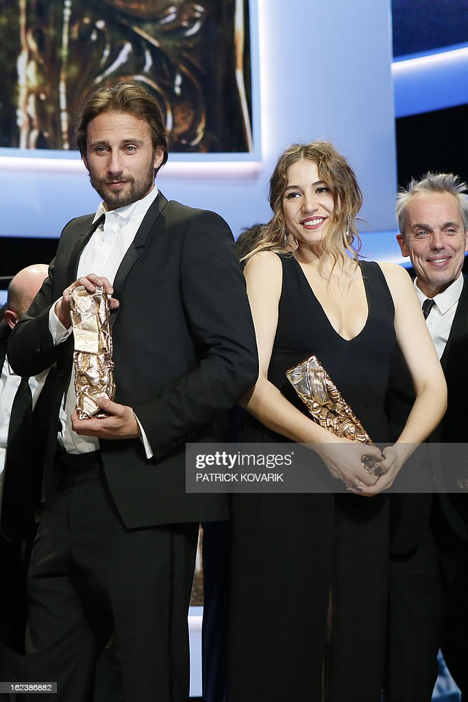 Belgian actor Matthias Schoenaerts (L) and French singer and actress Izia Higelin pose with their trophies at the end of the 38th Cesar Awards ceremony on February 22, 2013 at the Chatelet theatre in Paris. AFP PHOTO / PATRICK KOVARIK