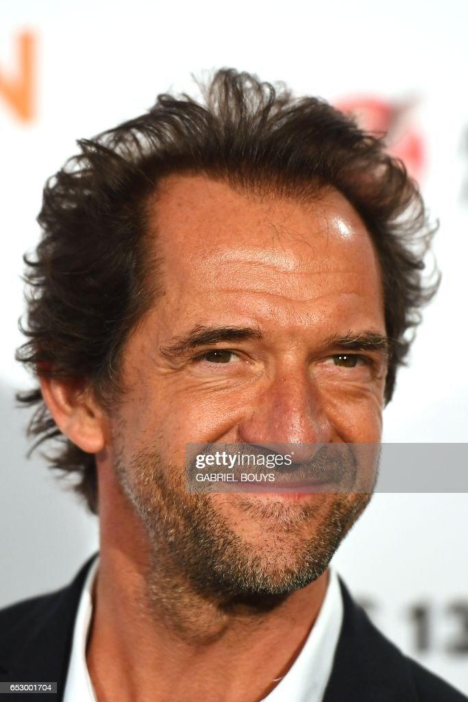 Belgian actor Stephane De Groodt poses during the photocall for the premiere of the film 'Chacun Sa Vie' in Paris on March 13, 2017. The film is directed by French director Claude Lelouch