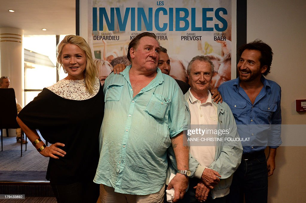 - Belgian actress Virginie Efira, French actors Gerard Depardieu, Daniel Prevost and Edouard Baer pose during the presentation of their latest movie, 'Les invincibles', on September 3, 2013 in Marseille. AFP PHOTO / ANNE-CHRISTINE POUJOULAT