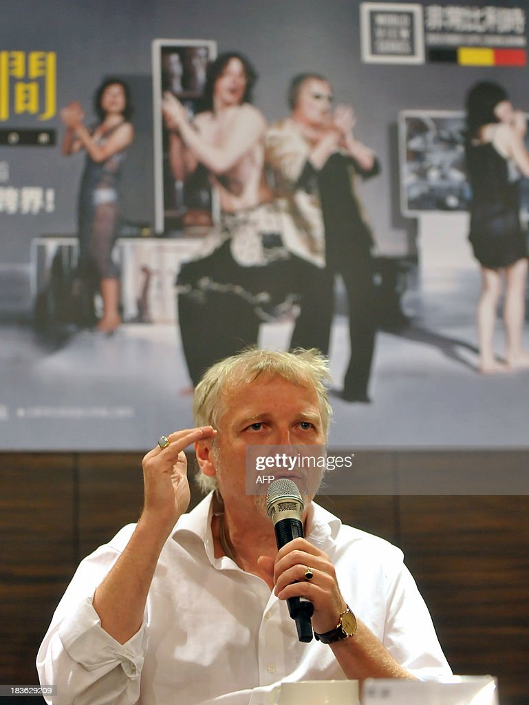 Belgian artist and theatre director Jan Lauwers speaks during a press conference at the National Theater Concert Hall (NTCH) in Taipei on October 8, 2013 as Needcompany will perform theatre work 'Isabella's Room' between October 11 to 13, 2013. The NTCH organized the 2013 World View Series 'Belgium' is launched between September 26 to December 8. AFP PHOTO / Mandy CHENG